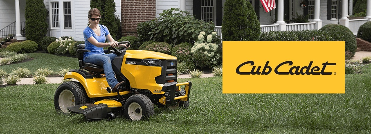 Woman riding Cub Cadet lawn mower